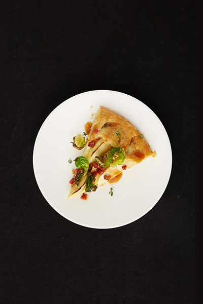 Savory Apple Galette with Pancetta and Brussels Sprout Leaves.